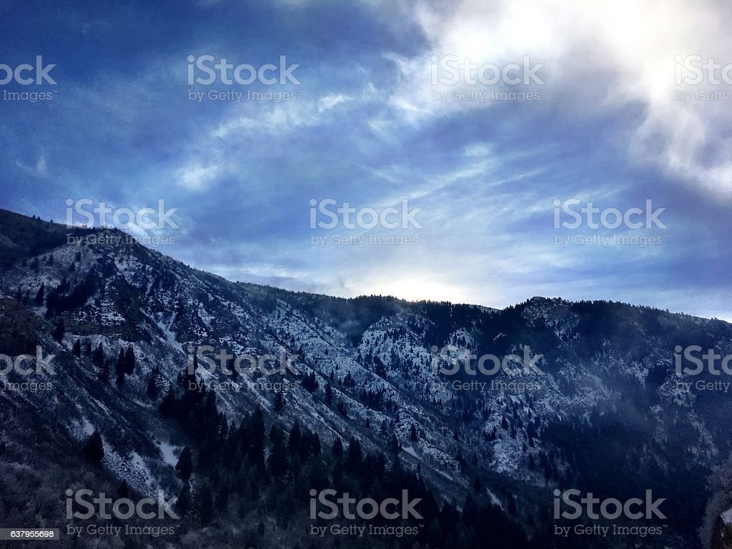 roadside view of utah mountains at sunrise stock photo