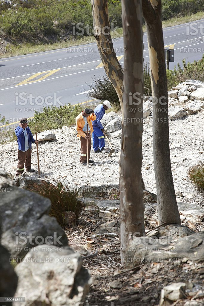 Roadside workers in South African countryside stock photo