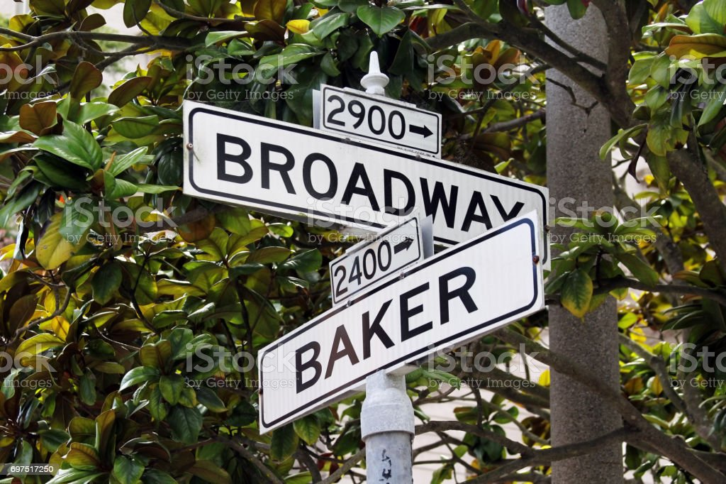 Roadsign Broadway Street and Baker Street in San Francisco stock photo