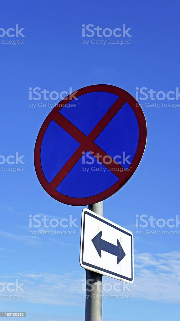 roadsign no parking under cloudy blue sky royalty-free stock photo