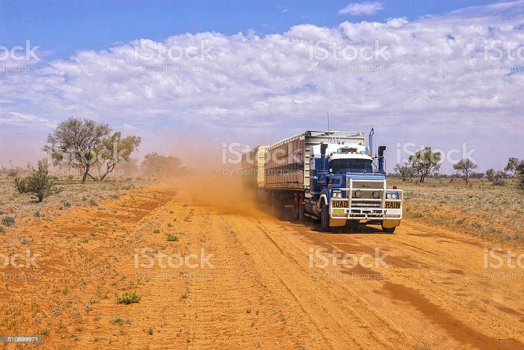 Roadtrain Kicking Up Dust stock photo