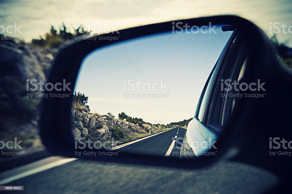 Roadtrip in rear side mirror stock photo