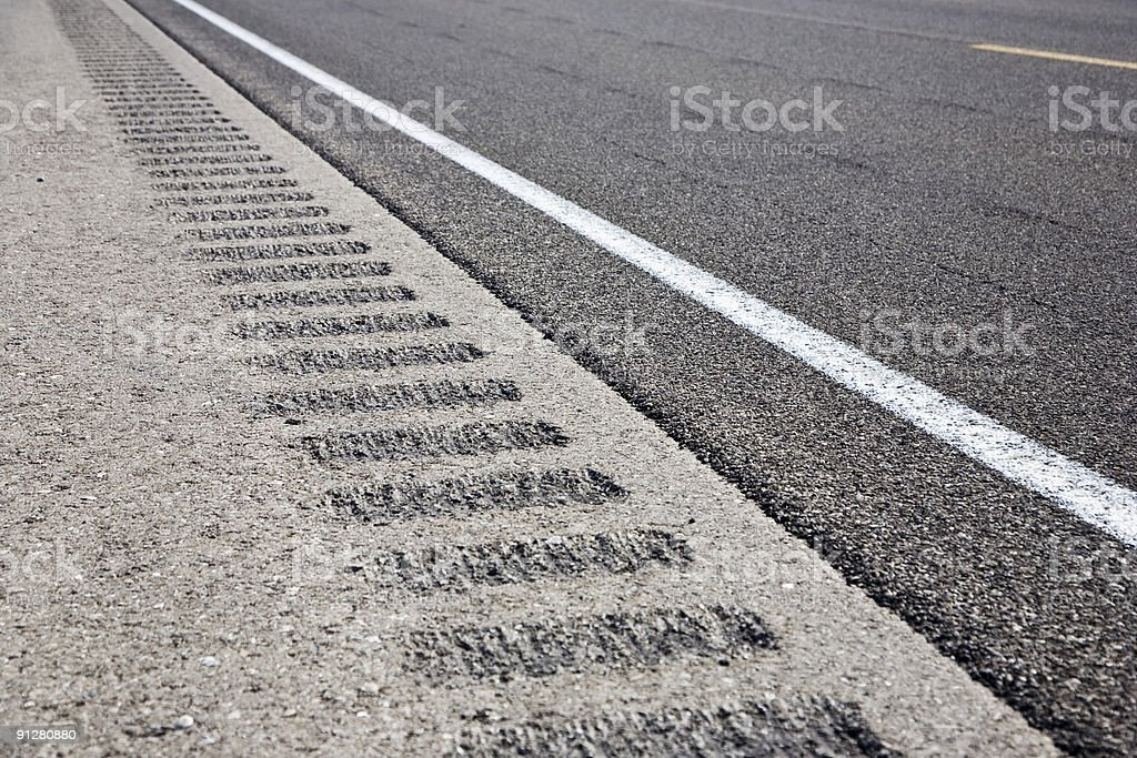 Roadway shoulder rumble strips royalty-free stock photo