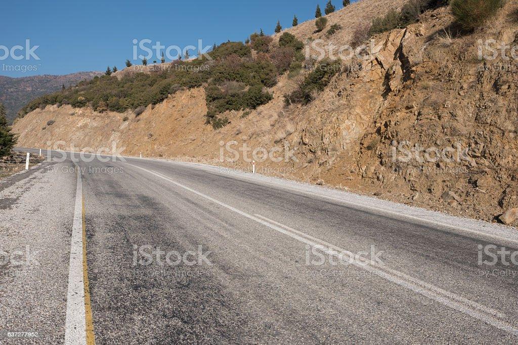 Roadway through the mountains stock photo