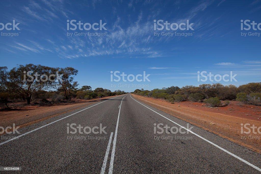 Roadway through the red bush stock photo