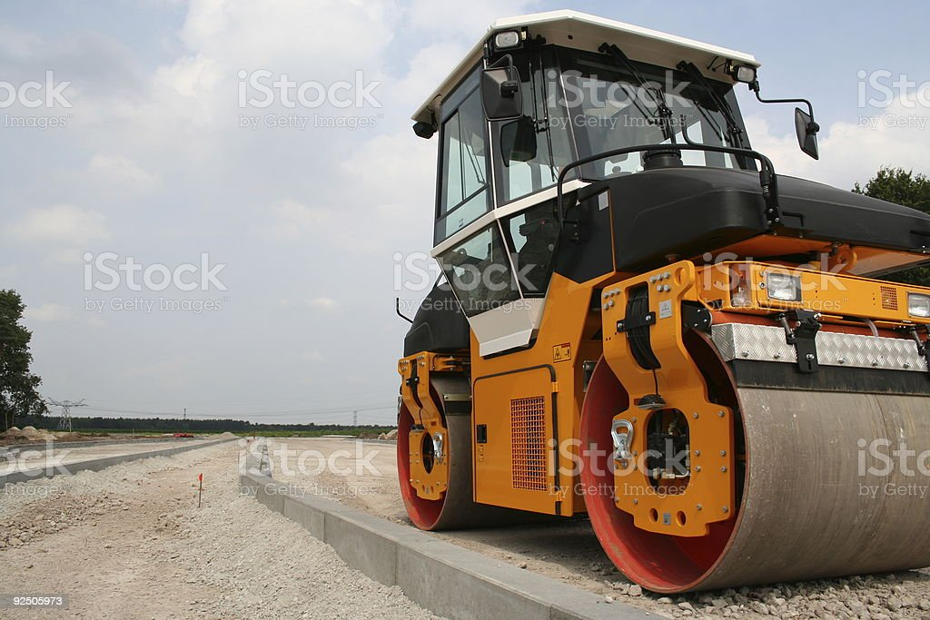 roadwork in progress with heavy roller royalty-free stock photo