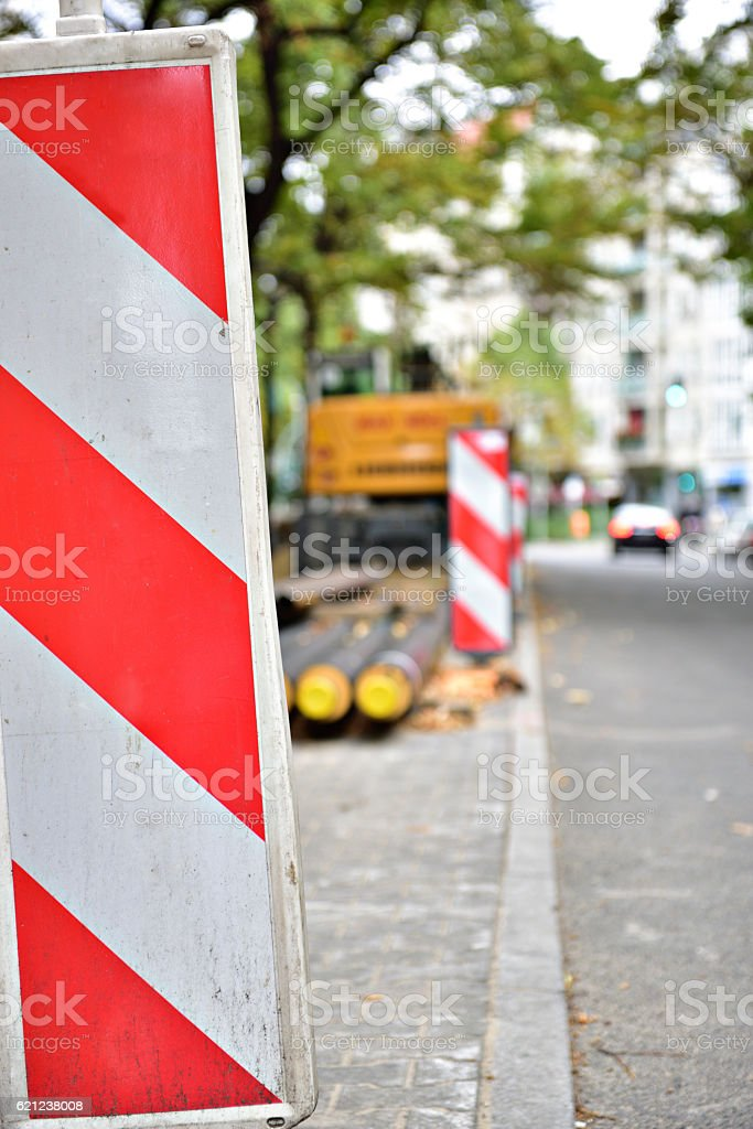 Roadwork ongoing. Digger. Traffic in background. stock photo