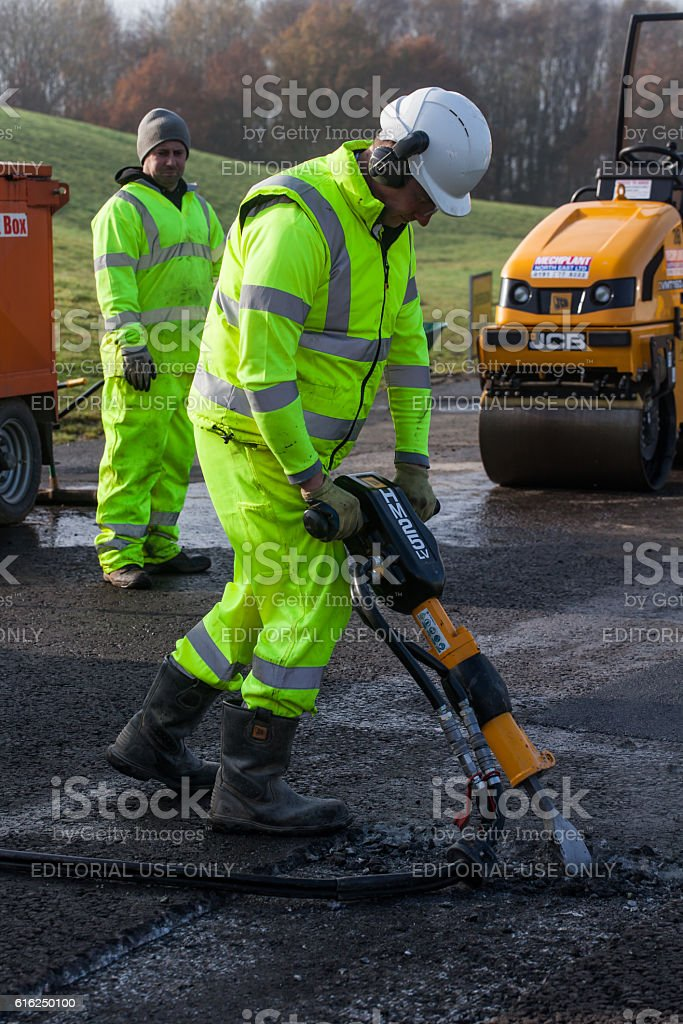 Roadworker using pneumatic drill or Jack Hammer. stock photo