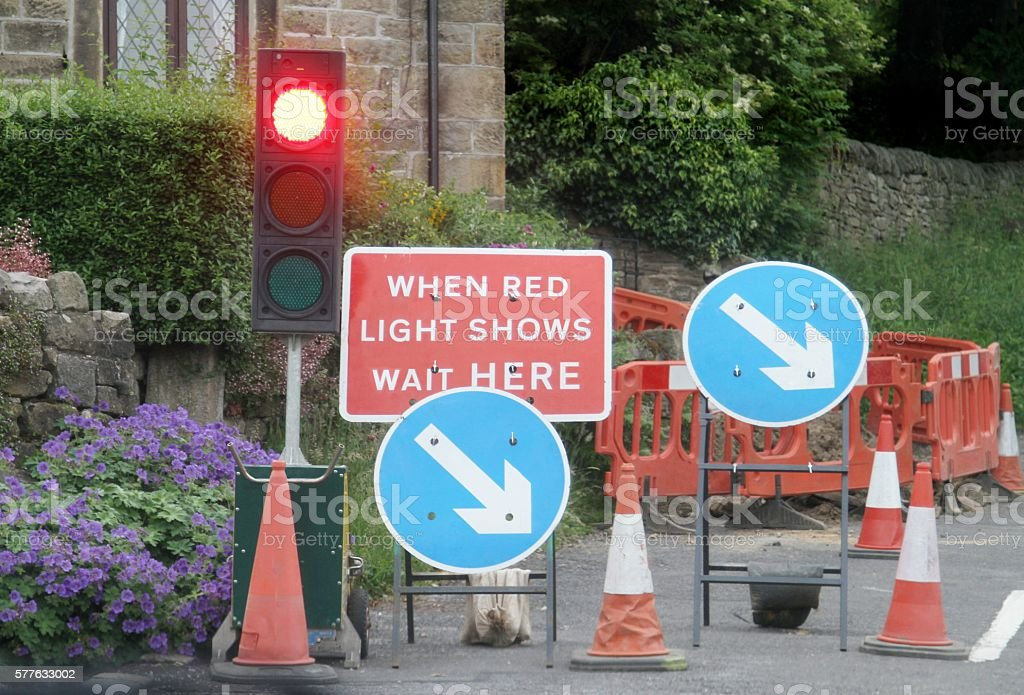 Roadworks with temporary traffic lights stock photo
