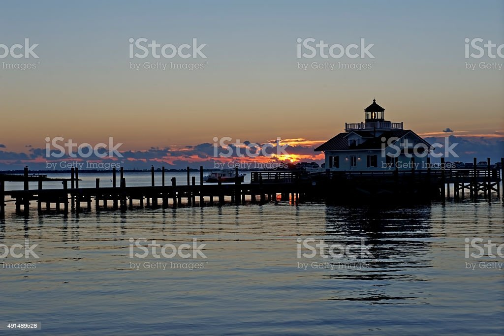 Roanoke Marshes Lighthouse at Sunrise stock photo