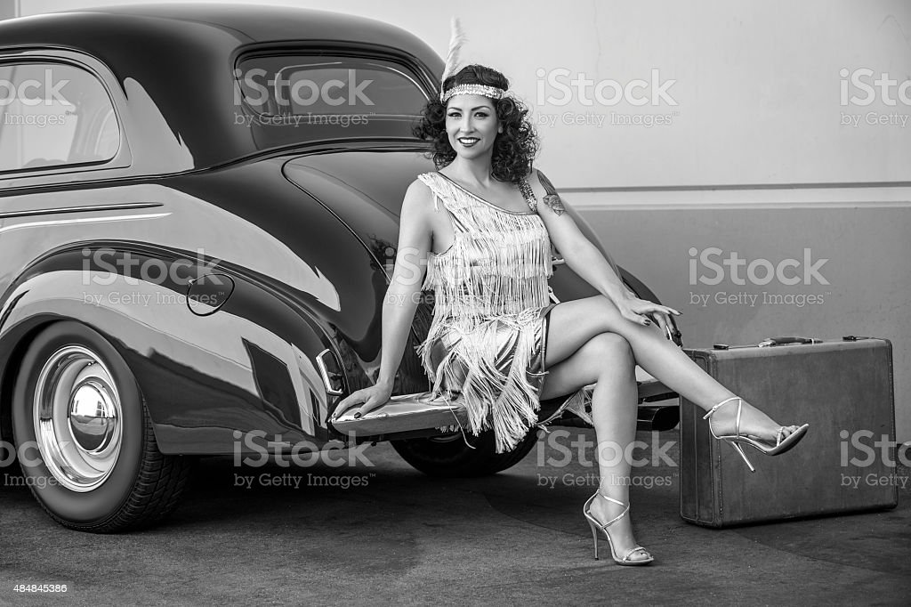 Roaring 20s Flapper with classic automobile stock photo