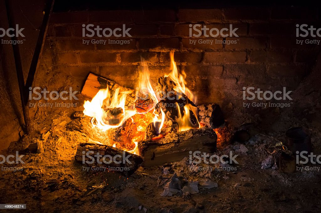 Roaring Fire In an Old Brick Fireplace stock photo
