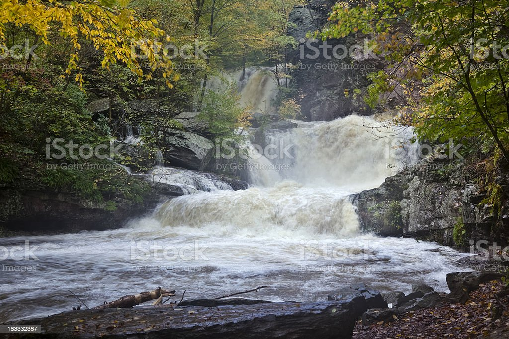 Roaring Waterfall in Autum After Heavy Rain - Time Exposure royalty-free stock photo