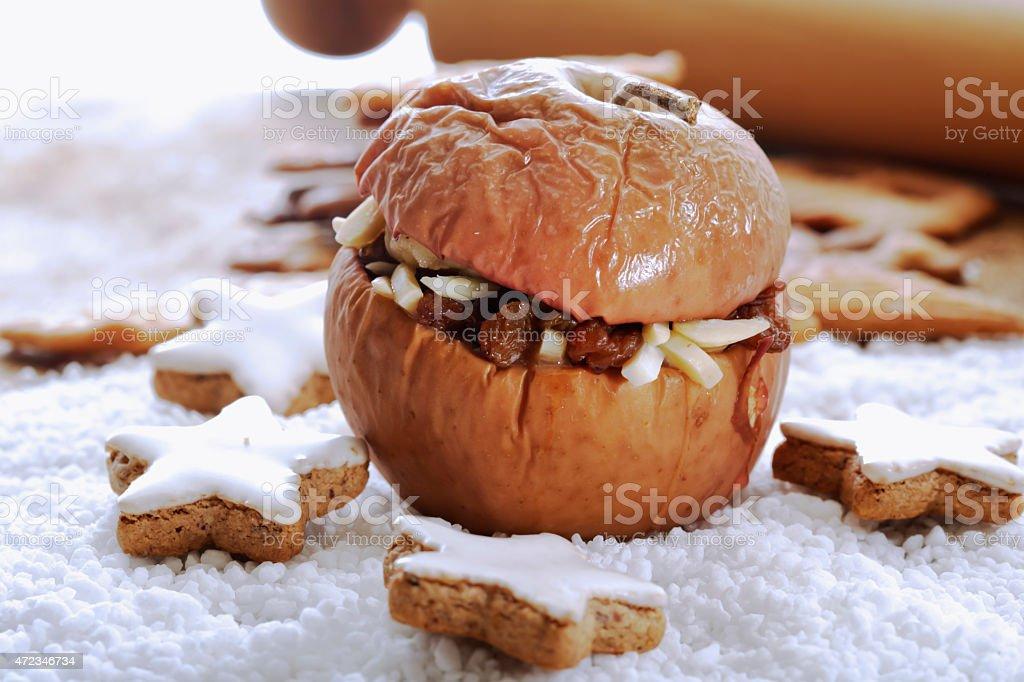 Roast apple with cinnamon stars and spekulatius cookies stock photo