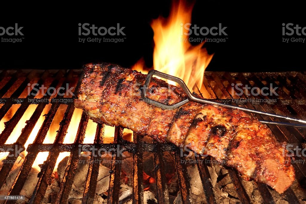 BBQ Roast Baby Back Pork Ribs Close-up On Hot  Grill stock photo