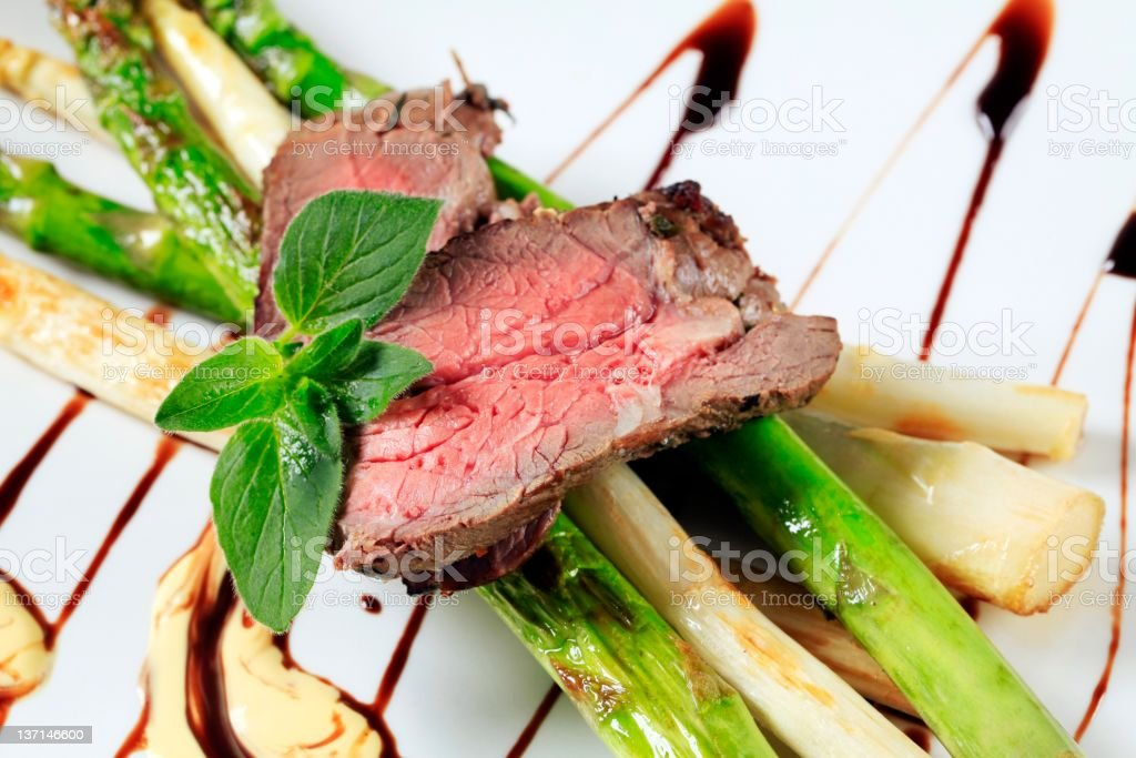 Roast beef and asparagus royalty-free stock photo