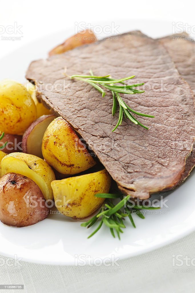 Roast beef and potatoes royalty-free stock photo