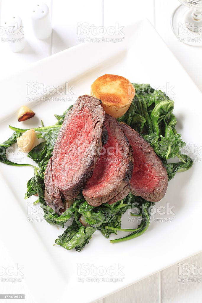 Roast beef and sauteed spinach royalty-free stock photo