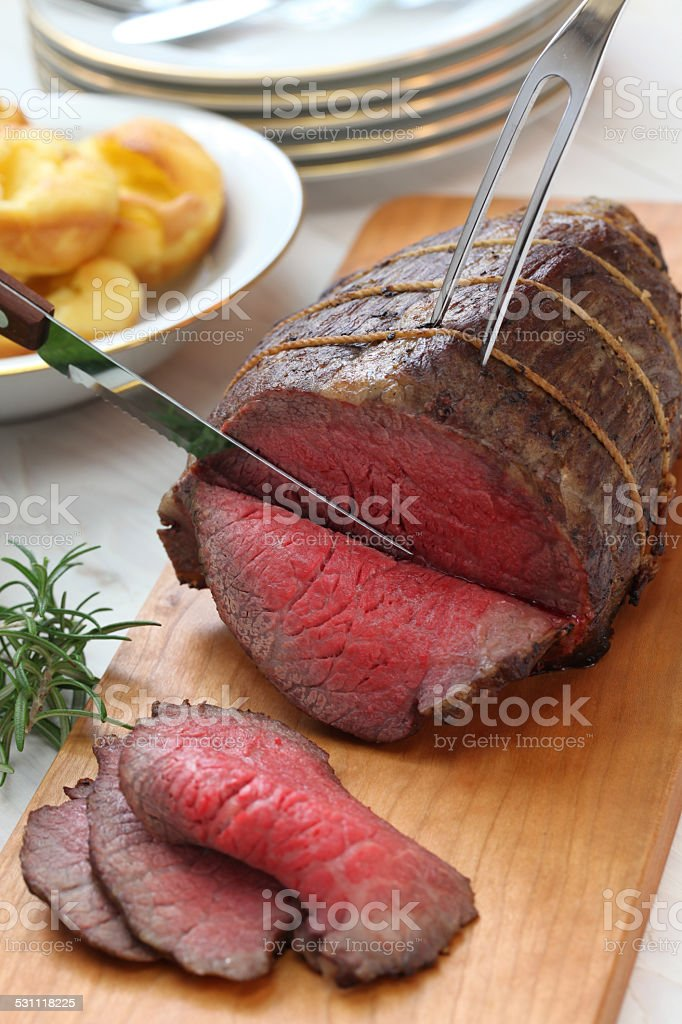 roast beef carving stock photo