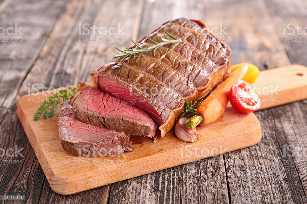 roast beef on board stock photo