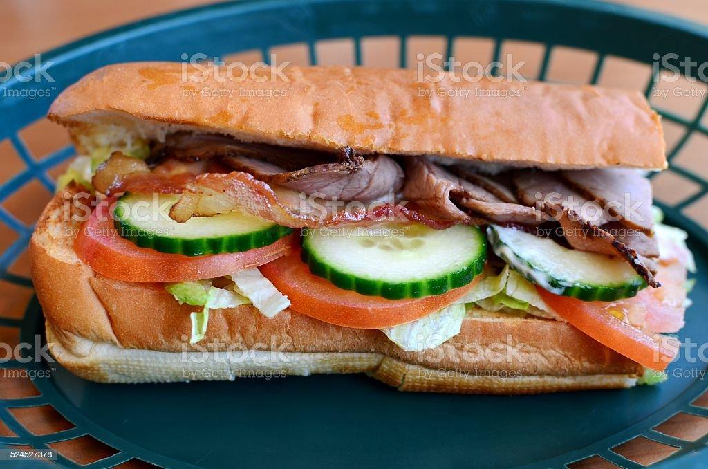 Roast beef sandwich with bacon stock photo