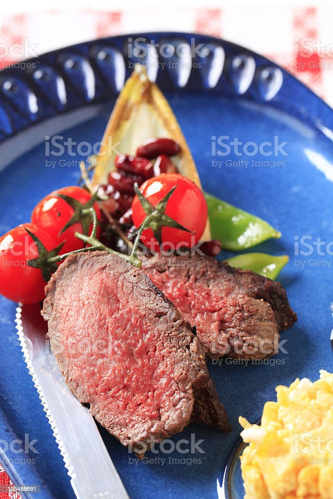 Roast beef, scrambled eggs and vegetables royalty-free stock photo
