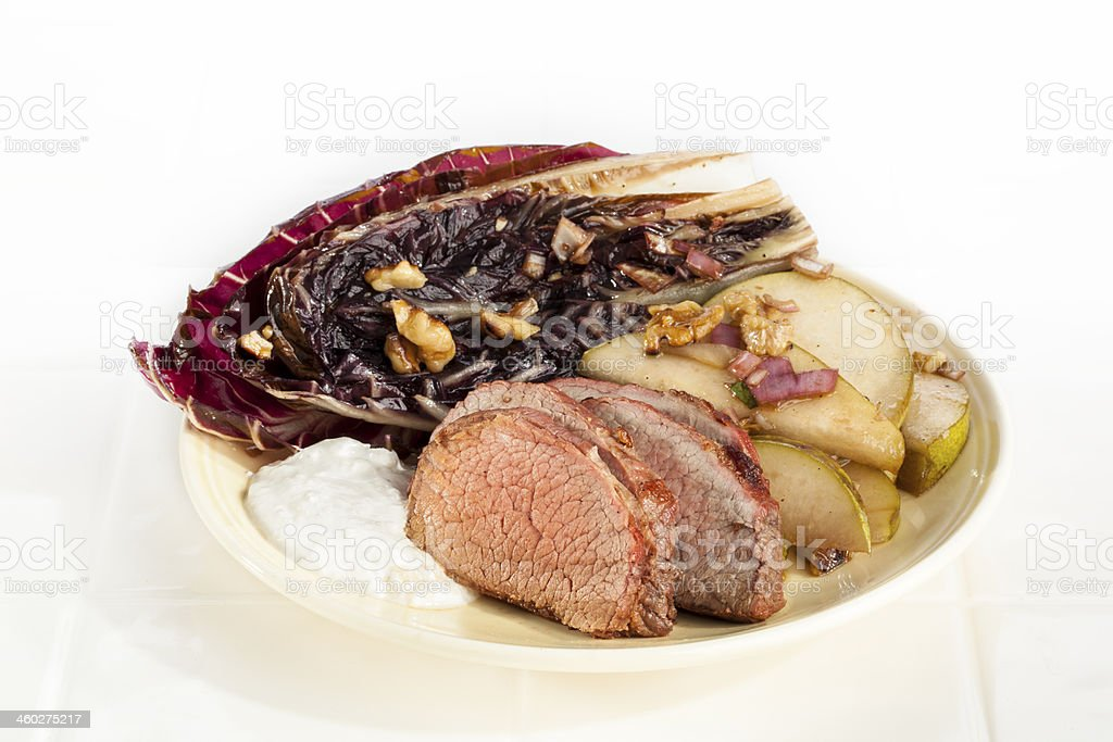 Roast Beef with Grilled Treviso and Pears stock photo