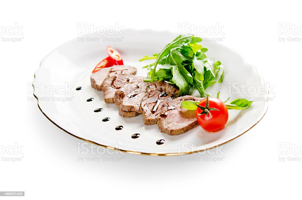 roast beef with lettuce on white background royalty-free stock photo
