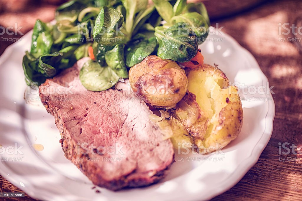 Roast Beef with Potatoes and Root Vegetables stock photo