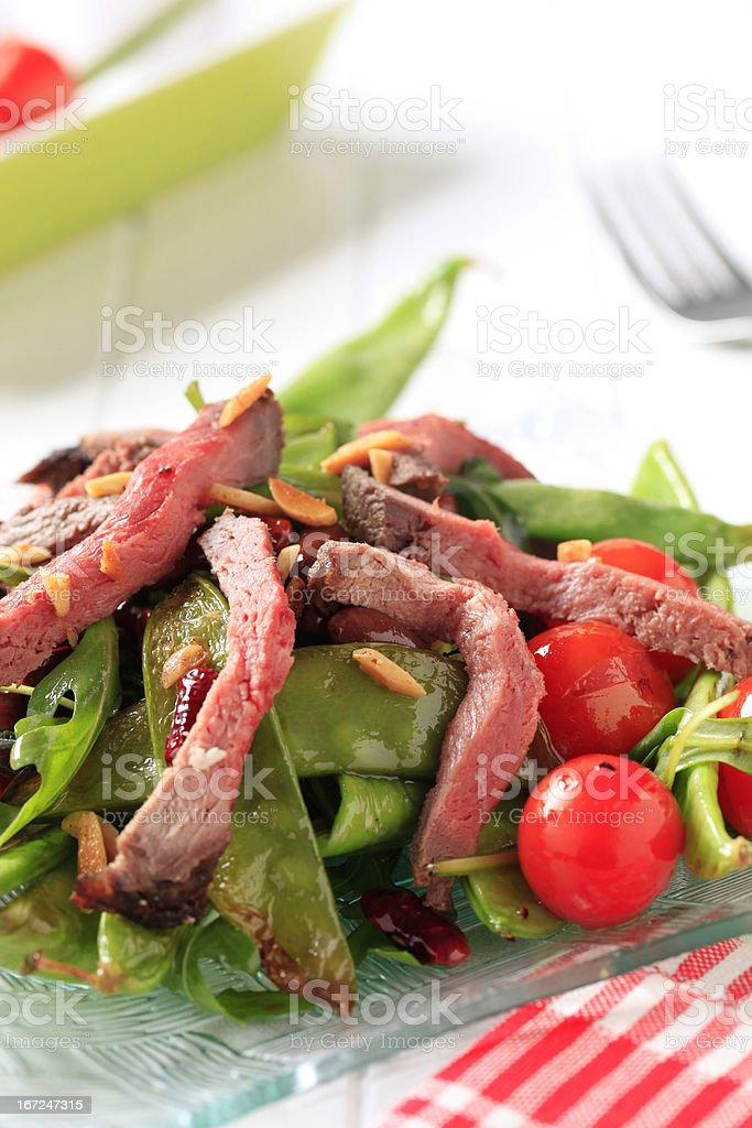 Roast beef with snow peas and arugula royalty-free stock photo