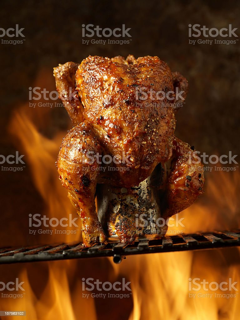 Roast Beer Can Chicken on the BBQ royalty-free stock photo