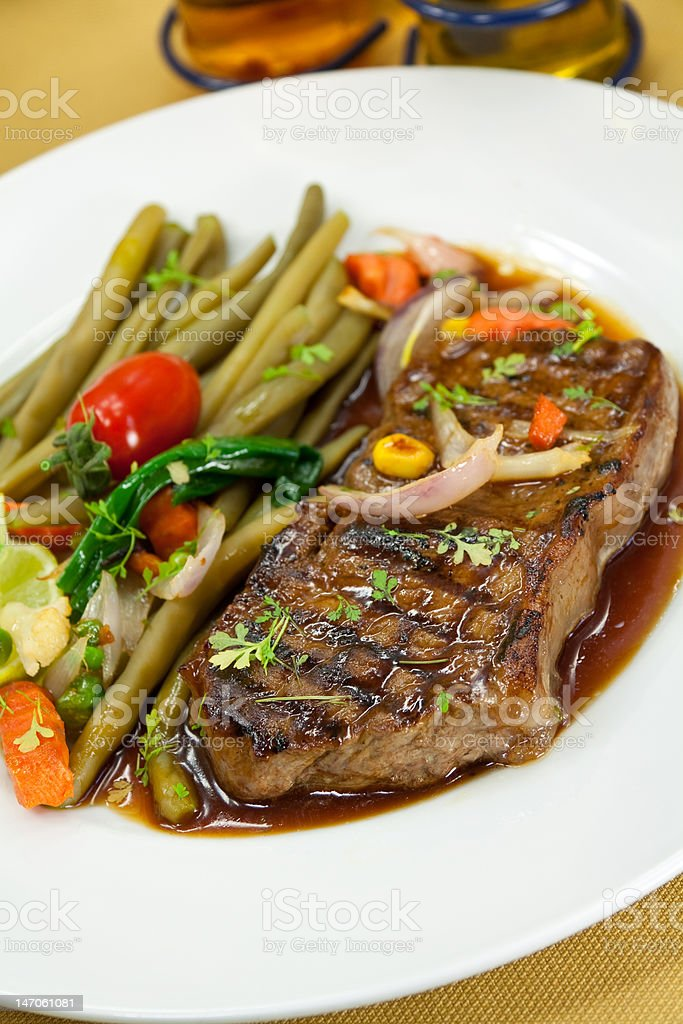 roast big steak on green dish close up royalty-free stock photo