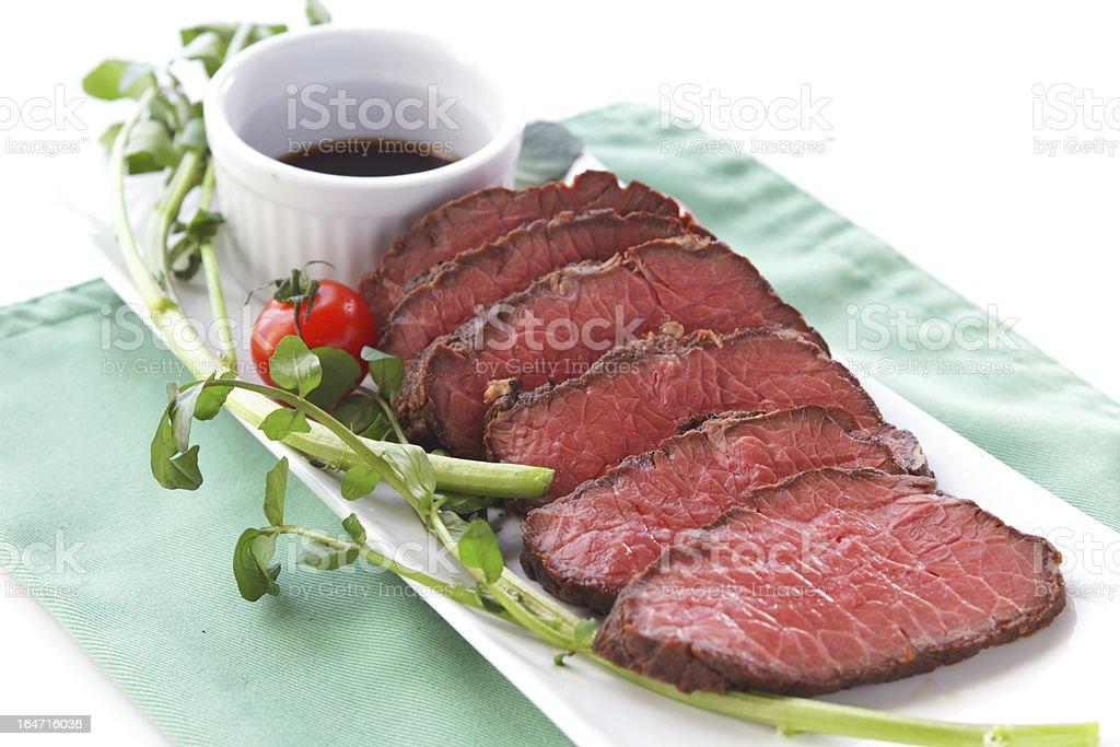 roast bloody slice on isolated white background royalty-free stock photo