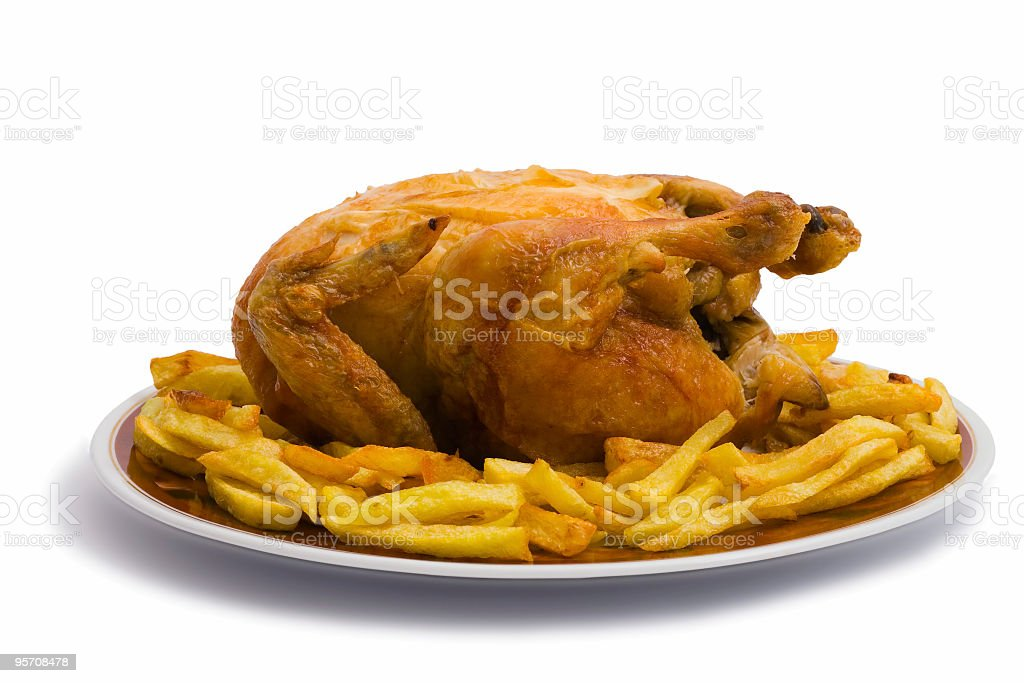 Roast chicken and french fries royalty-free stock photo