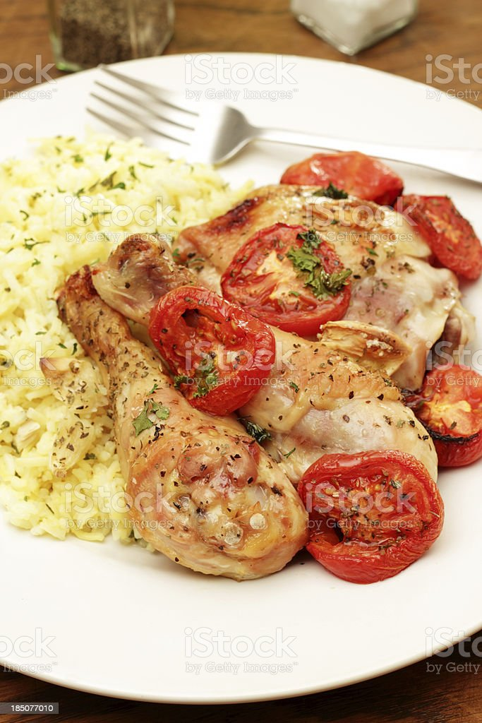 Roast Chicken and Tomatoes stock photo