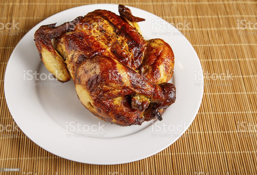 Roast Chicken at Angle on White Plate royalty-free stock photo