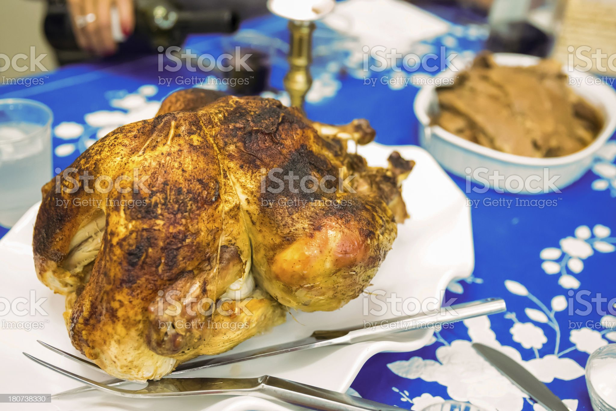 Roast chicken being served at dinner royalty-free stock photo