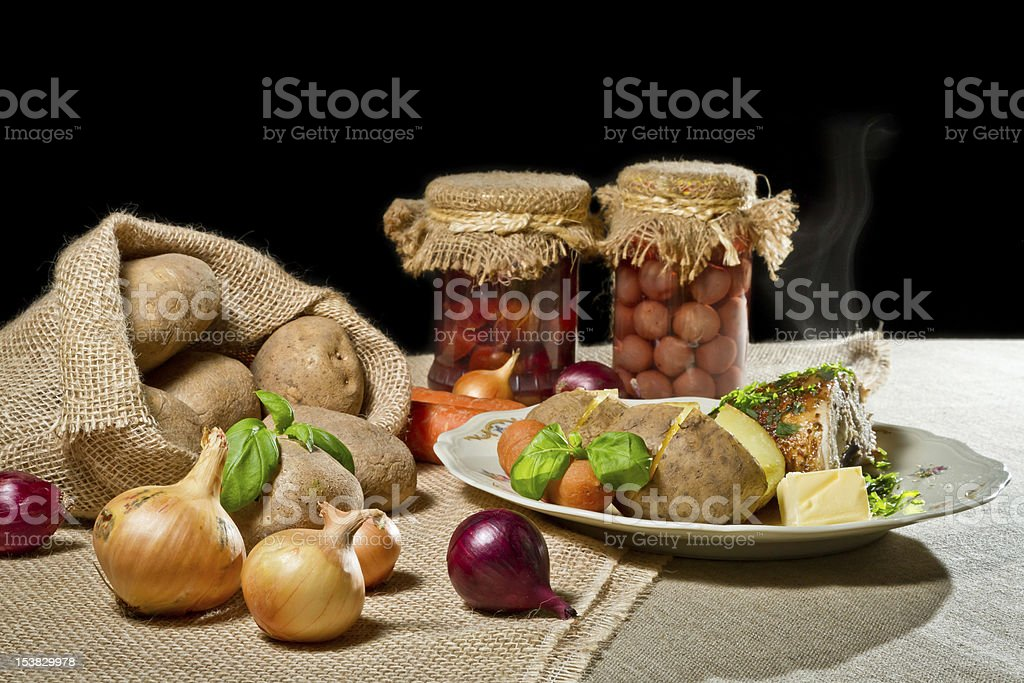 Roast chicken breast, jacket potatoes and stewed fruit as rural royalty-free stock photo