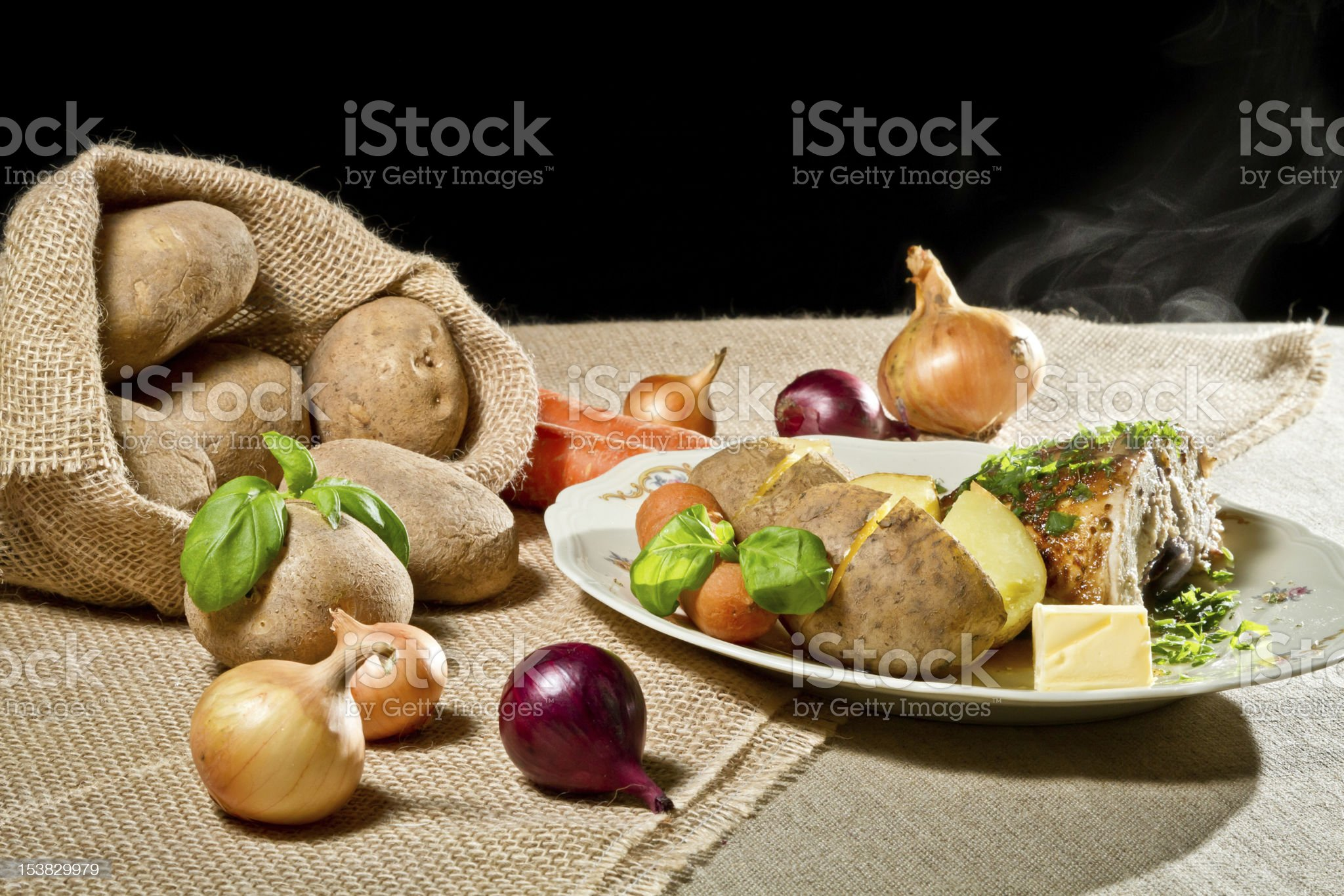 Roast chicken breast with vegetables and  jacket potatoes royalty-free stock photo