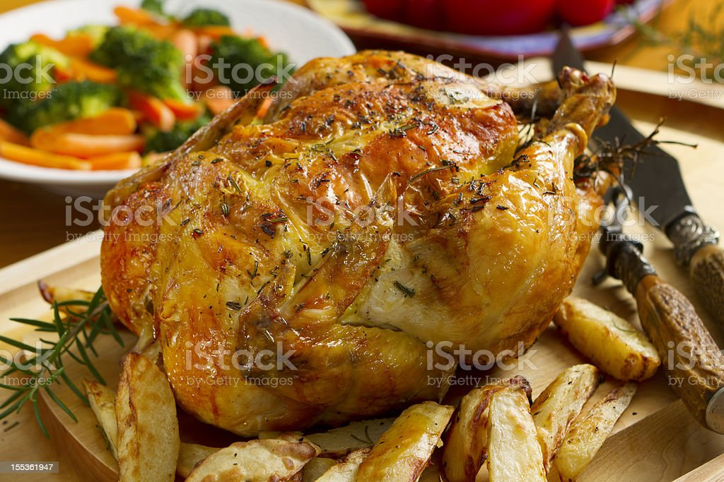 Roast chicken dinner, topped with thyme stock photo