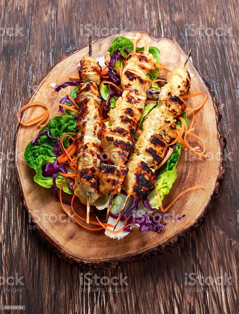 Roast Chicken filet kebab on bamboo sticks stock photo