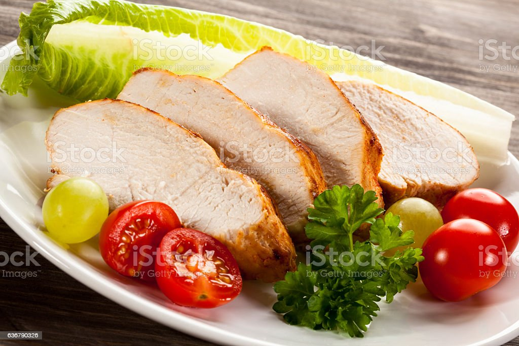 Roast chicken fillet and vegetables stock photo
