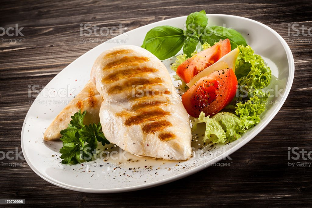 Roast chicken fillets and vegetables stock photo