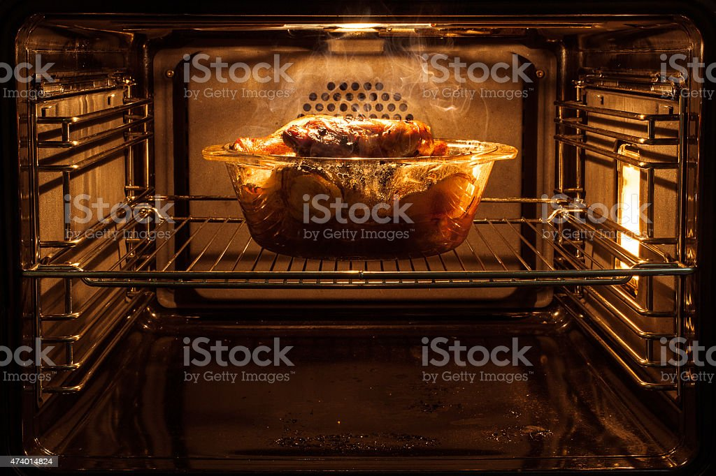 roast chicken in the oven stock photo