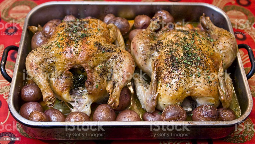Roast Chicken with Baby Red Potatoes royalty-free stock photo