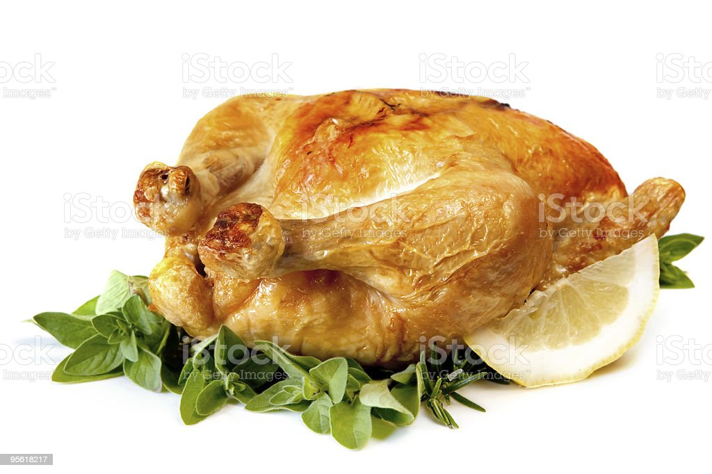 Roast chicken with lemon and fresh herbs royalty-free stock photo