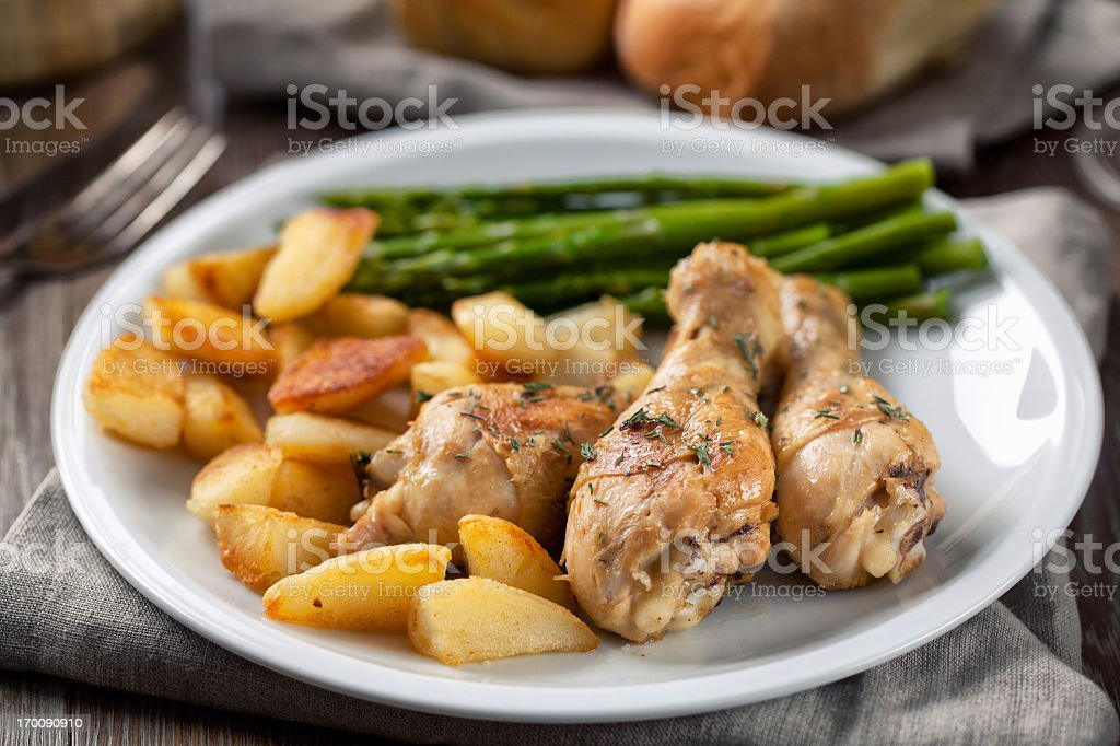 Roast chicken with potatoes and asparagus royalty-free stock photo