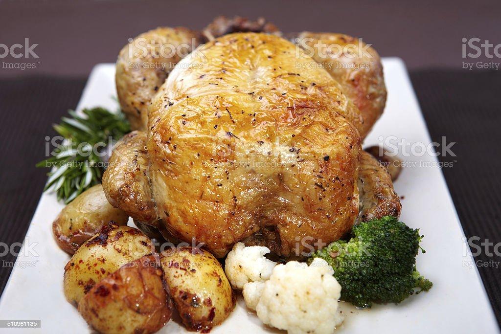 Roast Chicken with Potatoes, Cauliflower and Broccoli stock photo