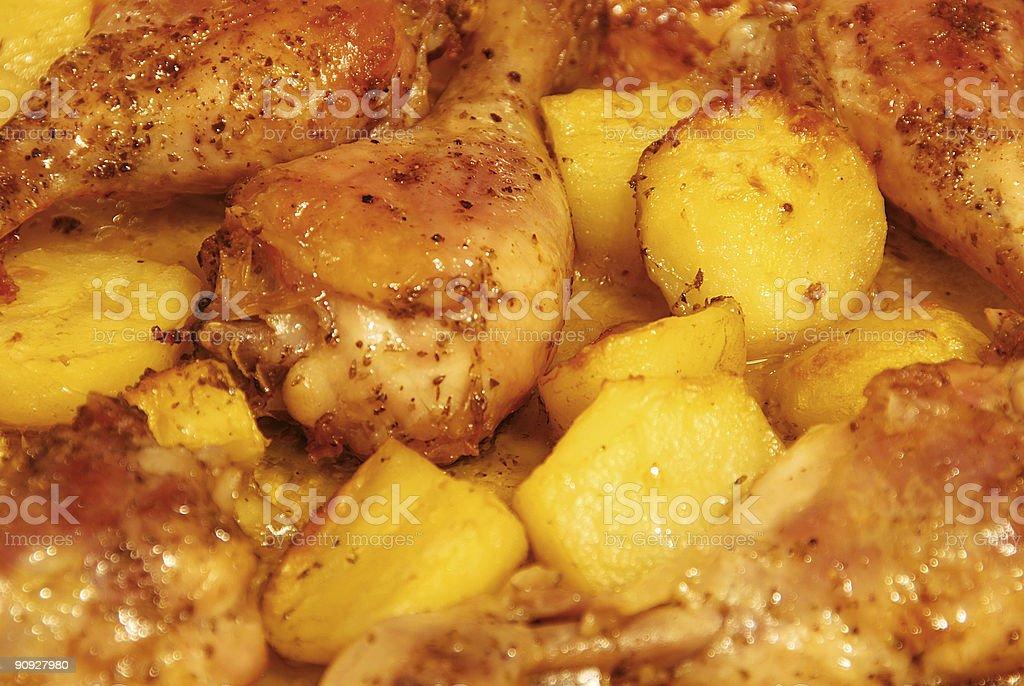 roast chicken with potatoes closeup royalty-free stock photo