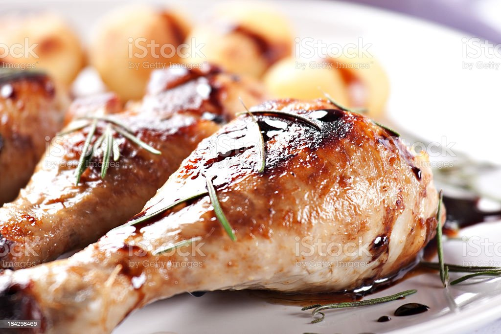 Roast chicken with potatoes on a plate royalty-free stock photo